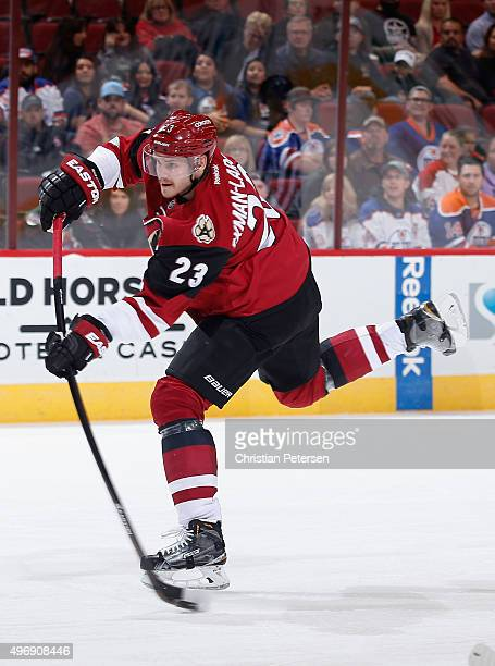 Oliver EkmanLarsson of the Arizona Coyotes shoots the puck against the Edmonton Oilers during the first period of the NHL game at Gila River Arena on...