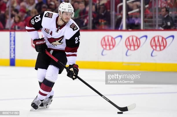 Oliver EkmanLarsson of the Arizona Coyotes skates with the puck against the Washington Capitals in the second period during an NHL game at Verizon...