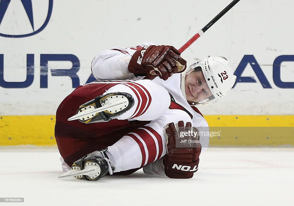 <a gi-track='captionPersonalityLinkClicked' href=/galleries/search?phrase=Oliver+Ekman-Larsson&family=editorial&specificpeople=5894618 ng-click='$event.stopPropagation()'>Oliver Ekman-Larsson</a> #23 of the Phoenix Coyotes appears to injure himself in the third period against the Anaheim Ducks at Honda Center on April 27, 2013 in Anaheim, California. The Coyotes defeated the Ducks 5-3.