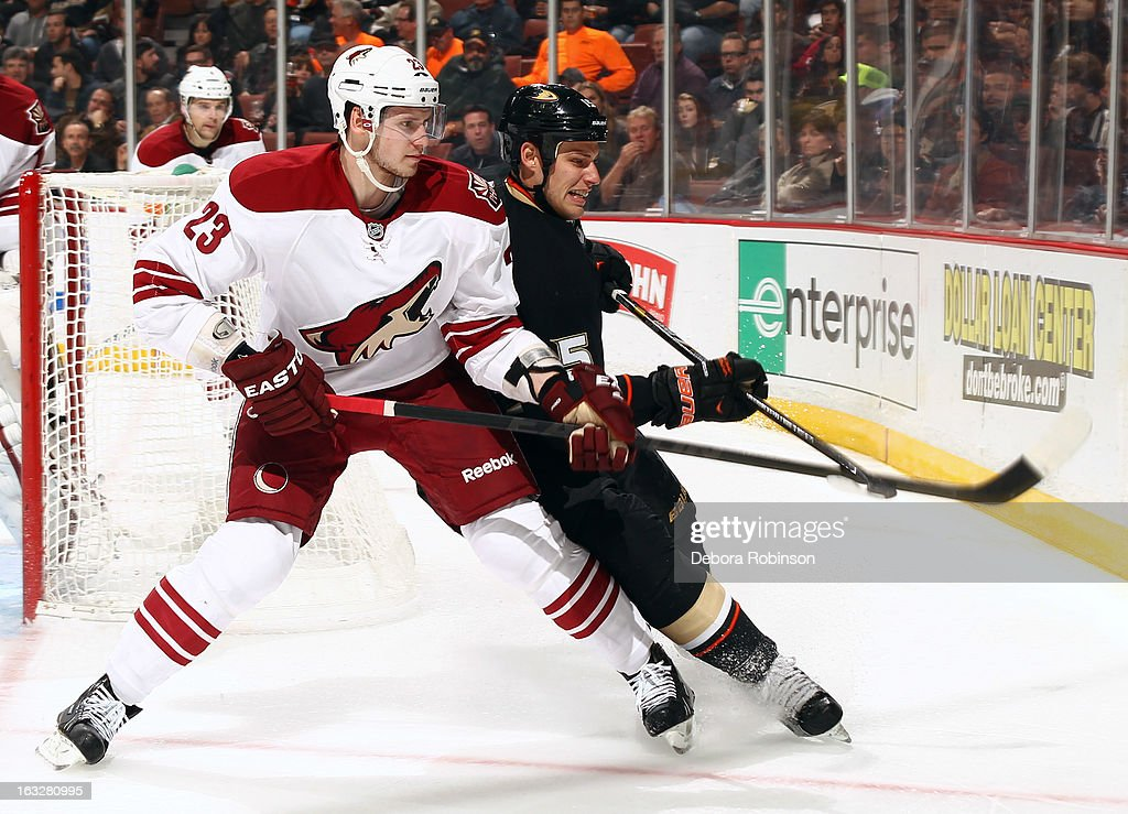 <a gi-track='captionPersonalityLinkClicked' href=/galleries/search?phrase=Oliver+Ekman-Larsson&family=editorial&specificpeople=5894618 ng-click='$event.stopPropagation()'>Oliver Ekman-Larsson</a> #23 of the Phoenix Coyotes battles for position against <a gi-track='captionPersonalityLinkClicked' href=/galleries/search?phrase=Ryan+Getzlaf&family=editorial&specificpeople=602655 ng-click='$event.stopPropagation()'>Ryan Getzlaf</a> #15 of the Anaheim Ducks on March 6, 2013 at Honda Center in Anaheim, California.