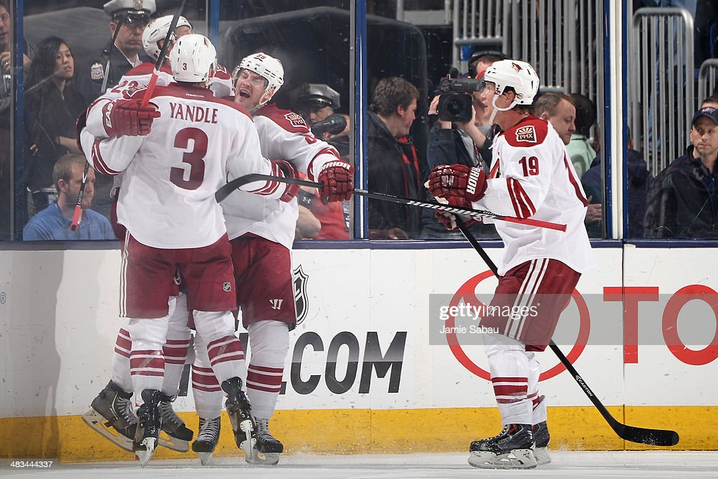 <a gi-track='captionPersonalityLinkClicked' href=/galleries/search?phrase=Oliver+Ekman-Larsson&family=editorial&specificpeople=5894618 ng-click='$event.stopPropagation()'>Oliver Ekman-Larsson</a> #23 of the Phoenix Coyotes celebrates his game-tying goal with teammates <a gi-track='captionPersonalityLinkClicked' href=/galleries/search?phrase=Keith+Yandle&family=editorial&specificpeople=606912 ng-click='$event.stopPropagation()'>Keith Yandle</a> #3, <a gi-track='captionPersonalityLinkClicked' href=/galleries/search?phrase=Mikkel+Boedker&family=editorial&specificpeople=4697252 ng-click='$event.stopPropagation()'>Mikkel Boedker</a> #89, and <a gi-track='captionPersonalityLinkClicked' href=/galleries/search?phrase=Shane+Doan&family=editorial&specificpeople=201614 ng-click='$event.stopPropagation()'>Shane Doan</a> #19 during the third period against the Columbus Blue Jackets on April 8, 2014 at Nationwide Arena in Columbus, Ohio. Columbus defeated Phoenix 4-3 in overtime.