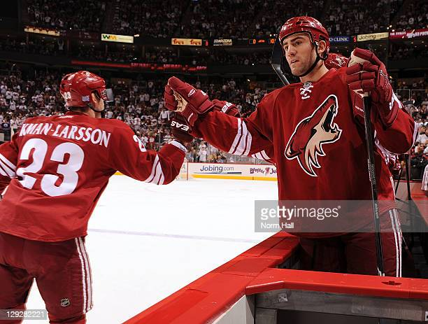 Oliver EkmanLarsson of the Phoenix Coyotes is congratulated by teammate Paul Bissonnette after his goal against the Winnipeg Jets on October 15 2011...