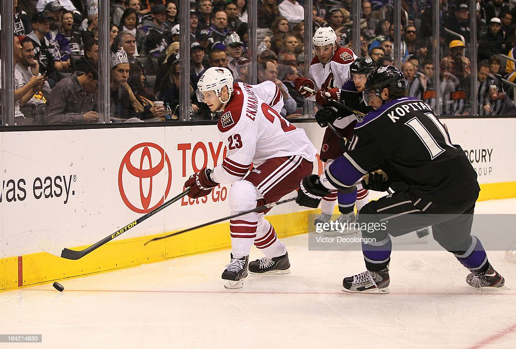 <a gi-track='captionPersonalityLinkClicked' href=/galleries/search?phrase=Oliver+Ekman-Larsson&family=editorial&specificpeople=5894618 ng-click='$event.stopPropagation()'>Oliver Ekman-Larsson</a> #23 of the Phoenix Coyotes plays the puck along the end boards as Anze Kopitar #11 of the Los Angeles Kings defends the play during the NHL game at Staples Center on March 18, 2013 in Los Angeles, California. The Kings defeated the Coyotes 4-0.