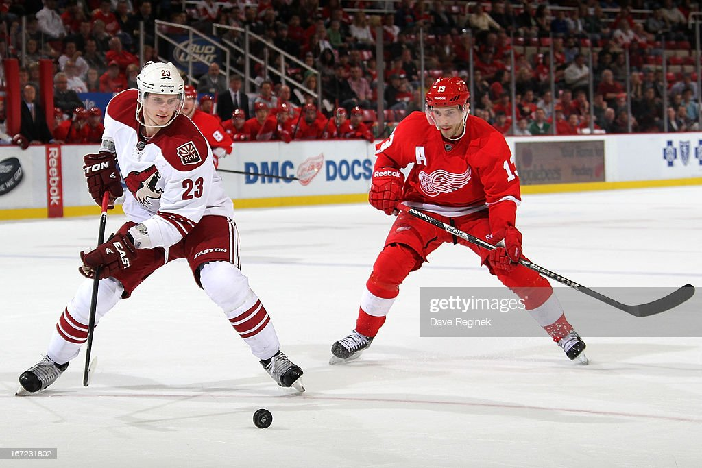 <a gi-track='captionPersonalityLinkClicked' href=/galleries/search?phrase=Oliver+Ekman-Larsson&family=editorial&specificpeople=5894618 ng-click='$event.stopPropagation()'>Oliver Ekman-Larsson</a> #23 of the Phoenix Coyotes reaches for the puck as <a gi-track='captionPersonalityLinkClicked' href=/galleries/search?phrase=Pavel+Datsyuk&family=editorial&specificpeople=202893 ng-click='$event.stopPropagation()'>Pavel Datsyuk</a> #13 of the Detroit Red Wings skates behind him during a NHL game at Joe Louis Arena on April 22, 2013 in Detroit, Michigan. Detroit defeated Phoenix 4-0