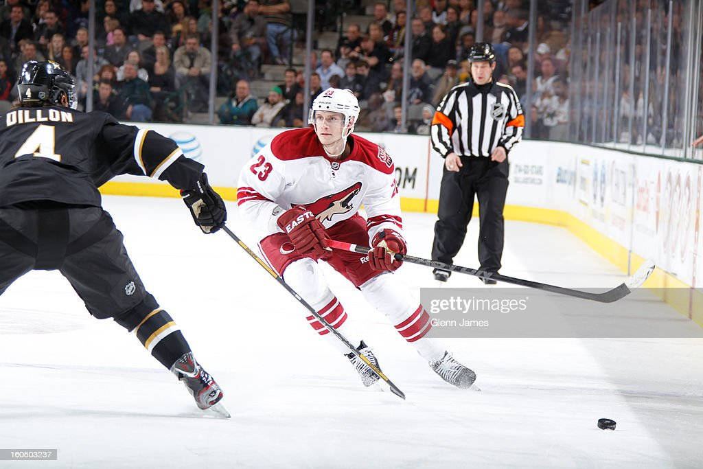<a gi-track='captionPersonalityLinkClicked' href=/galleries/search?phrase=Oliver+Ekman-Larsson&family=editorial&specificpeople=5894618 ng-click='$event.stopPropagation()'>Oliver Ekman-Larsson</a> #23 of the Phoenix Coyotes skates against Brenden Dillon #4 of the Dallas Stars at the American Airlines Center on February 1, 2013 in Dallas, Texas.