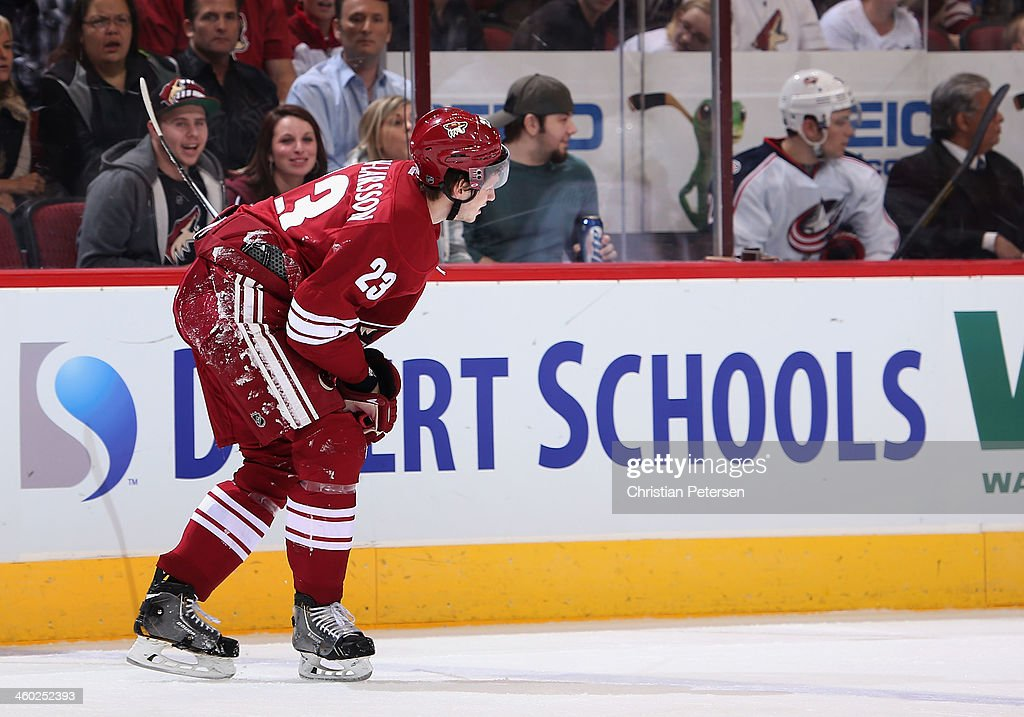 <a gi-track='captionPersonalityLinkClicked' href=/galleries/search?phrase=Oliver+Ekman-Larsson&family=editorial&specificpeople=5894618 ng-click='$event.stopPropagation()'>Oliver Ekman-Larsson</a> #23 of the Phoenix Coyotes skates off the ice with an injury after a hard check during the first period of the NHL game against the Columbus Blue Jackets at Jobing.com Arena on January 2, 2014 in Glendale, Arizona. The Blue Jackets defeated the Coyotes 2-0.