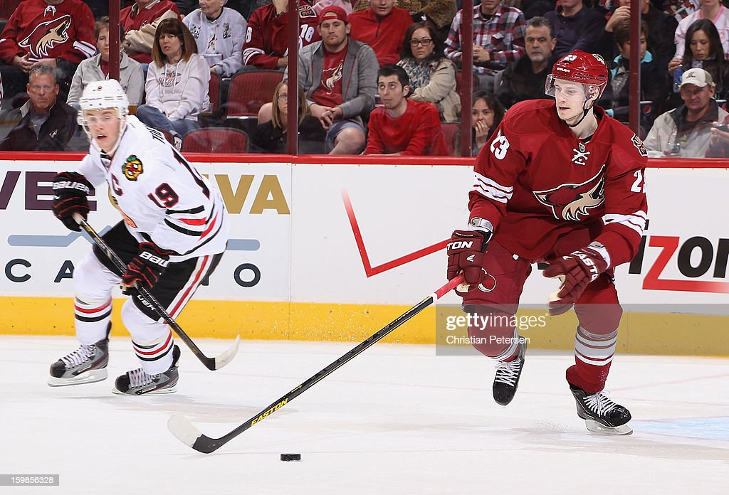 <a gi-track='captionPersonalityLinkClicked' href=/galleries/search?phrase=Oliver+Ekman-Larsson&family=editorial&specificpeople=5894618 ng-click='$event.stopPropagation()'>Oliver Ekman-Larsson</a> #23 of the Phoenix Coyotes skates with the puck ahead of <a gi-track='captionPersonalityLinkClicked' href=/galleries/search?phrase=Jonathan+Toews&family=editorial&specificpeople=537799 ng-click='$event.stopPropagation()'>Jonathan Toews</a> #19 of the Chicago Blackhawks during the NHL game at Jobing.com Arena on January 20, 2013 in Glendale, Arizona. The Blackhawks defeated the Coyotes 6-4.