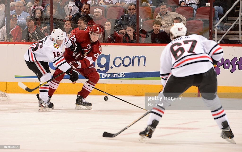 <a gi-track='captionPersonalityLinkClicked' href=/galleries/search?phrase=Oliver+Ekman-Larsson&family=editorial&specificpeople=5894618 ng-click='$event.stopPropagation()'>Oliver Ekman-Larsson</a> #23 of the Phoenix Coyotes tries to clear the puck away from Marcus Kruger #16 of the Chicago Blackhawks as Blackhawks' <a gi-track='captionPersonalityLinkClicked' href=/galleries/search?phrase=Michael+Frolik&family=editorial&specificpeople=537965 ng-click='$event.stopPropagation()'>Michael Frolik</a> #67 looks to keep the puck in the zone at Jobing.com Arena on February 7, 2013 in Glendale, Arizona.
