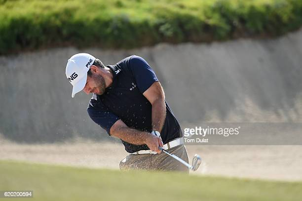 Oliver Farr of Wales hits from a bunker on the 4th hole during day one of the NBO Golf Classic Grand Final at Al Mouj Golf on November 2 2016 in...