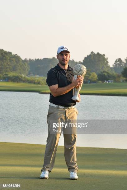 Oliver Farr of Wales holds the trophy after winning the 2017 Foshan Open at the Foshan Golf Club on October 22 2017 in Foshan China