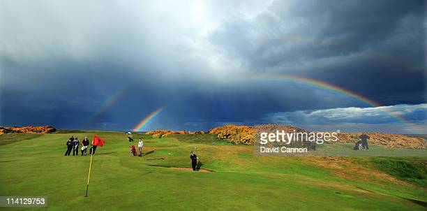 Oliver Farr of Wales plays a bunker shot with a rainbow in the sky behind during the 2011 Walker Cup Squad practice session at Royal Aberdeen Golf...
