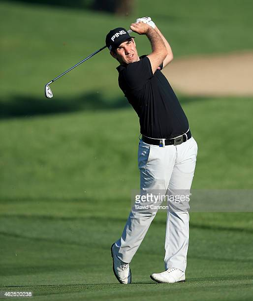 Oliver Farr of Wales plays his third shot on the par 5 10th hole during the second round of the 2015 Omega Dubai Desert Classic on the Majlis Course...