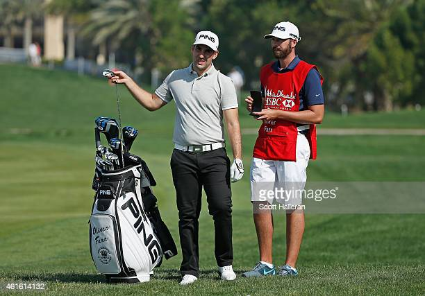 Oliver Farr of Wales pulls a club on the first hole during the second round of the Abu Dhabi HSBC Golf Championship at the Abu Dhabi Golf Cub on...