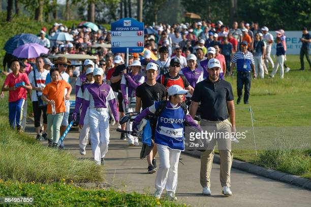 Oliver Farr of Wales walk the fairway in the 18th hole during the final round of the 2017 Foshan Open at the Foshan Golf Club on October 22 2017 in...