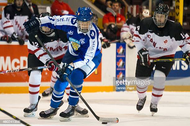 Oliver Felixson of Finland moves the puck against Jordan Maher of Canada White during the World Under17 Hockey Challenge on November 2 2014 at the...
