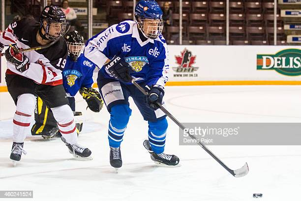 Oliver Felixson of Finland moves the puck against Travis Barron of Canada White during the World Under17 Hockey Challenge on November 2 2014 at the...