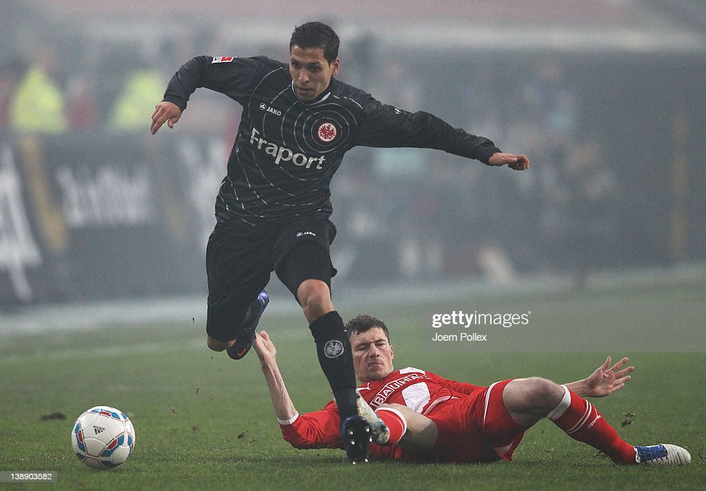 Oliver Fink (R) of Duesseldorf and <a gi-track='captionPersonalityLinkClicked' href=/galleries/search?phrase=Karim+Matmour&family=editorial&specificpeople=741965 ng-click='$event.stopPropagation()'>Karim Matmour</a> of Frankfurt battle for the ball during the Second Bundesliga match between Fortuna Duesseldorf and Eintracht Frankfurt on February 13, 2012 in Duesseldorf, Germany.