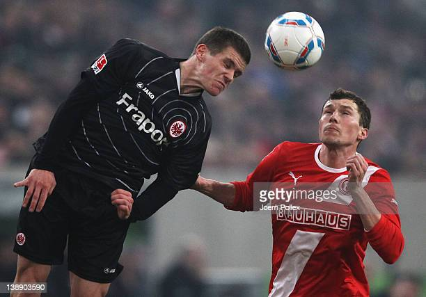Oliver Fink of Duesseldorf and Sebastian Jung of Frankfurt battle for the ball during the Second Bundesliga match between Fortuna Duesseldorf and...
