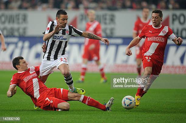 Oliver Fink of Duesseldorf and teammate Andreas Lambertz challenge Deniz Naki of St Pauli during the Second Bundesliga match between Fortuna...