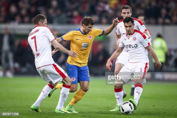 Oliver Fink of Duesseldorf Hendrick Zuck of Braunschweig and Kaan Ayhan of Duesseldorf battle for the ball during the Second Bundesliga match between...
