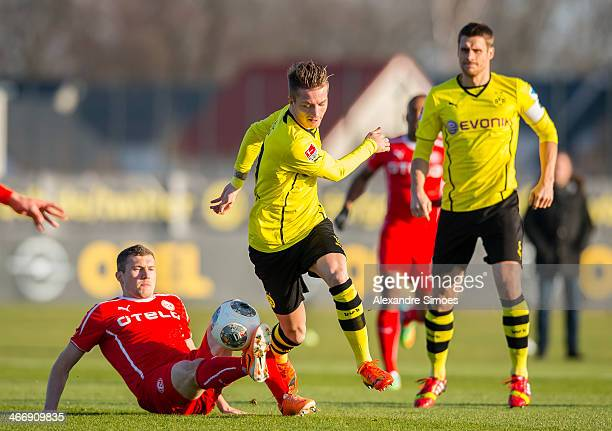 Oliver Fink of Fortuns Duesseldorf in action with Marco Reus during the friendly match between Borussia Dortmund and Fortuna Duesseldorf at Signal...