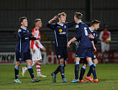 Oliver Finney Jon Moran Toby Mullarkey and Harry Pickering of Crewe celebrate winning at the end of the match between Arsenal U18 and Crewe Alexandra...