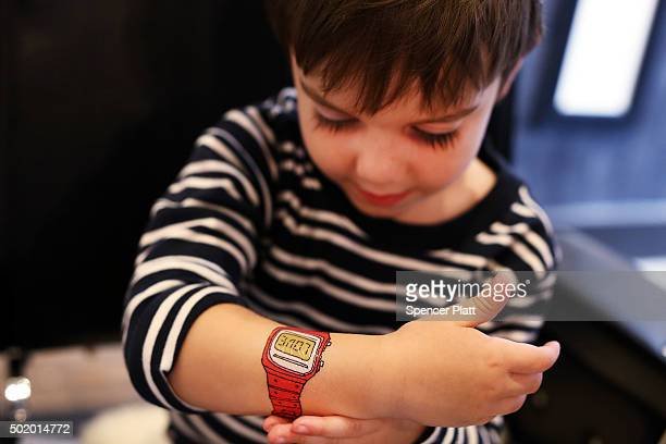 Oliver Fischer displays his new temporary tattoo at Tattly Temporary Tattoos in Brooklyn on December 18 2015 in New York City Housed inside the...