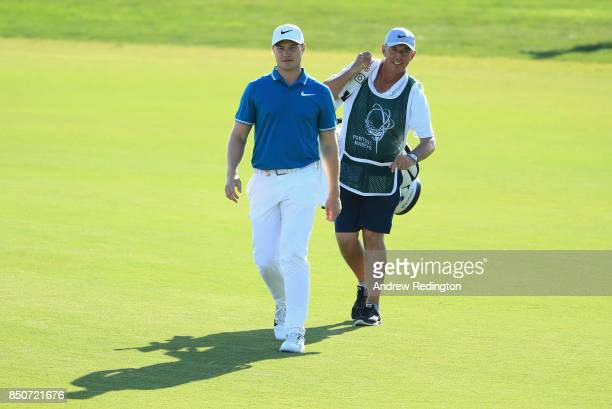Oliver Fisher of England and caddie Phil Morbey on the 17th during day one of the 2017 Portugal Masters at Dom Pedro Victoria Golf Club on September...