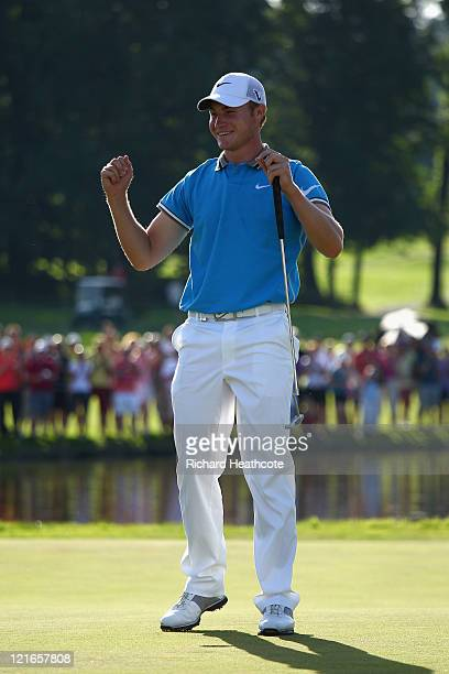 Oliver Fisher of England celebrates holing the winning putt on his way to victory during the final round of the Czech Open 2011 at Prosper Golf...