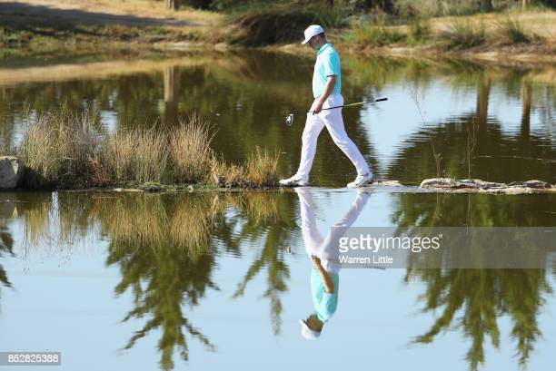 Oliver Fisher of England crosses to the 17th tee during day four of the Portugal Masters at Dom Pedro Victoria Golf Club on September 24 2017 in...