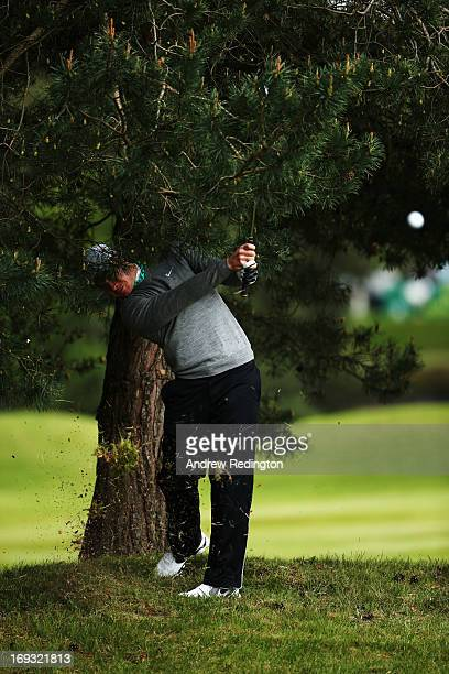 Oliver Fisher of England hits his 2nd shot on the 9th hole during the first round of the BMW PGA Championship on the West Course at Wentworth on May...