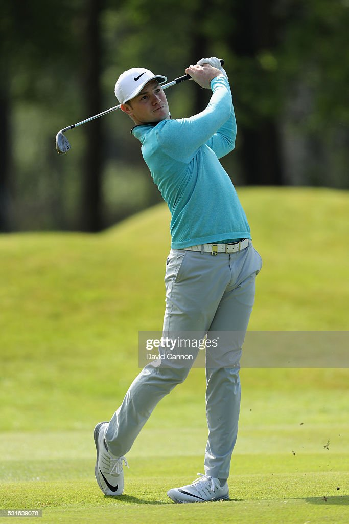 Oliver Fisher of England hits his 3rd shot on the 9th hole during day two of the BMW PGA Championship at Wentworth on May 27, 2016 in Virginia Water, England.