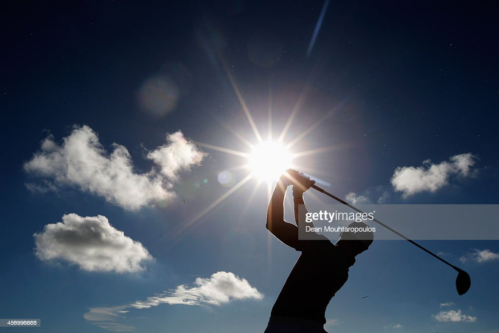 Oliver Fisher of England hits his practice shot on the driving range during Day 2 of the Portugal Masters held at the Oceanico Victoria Golf Course...