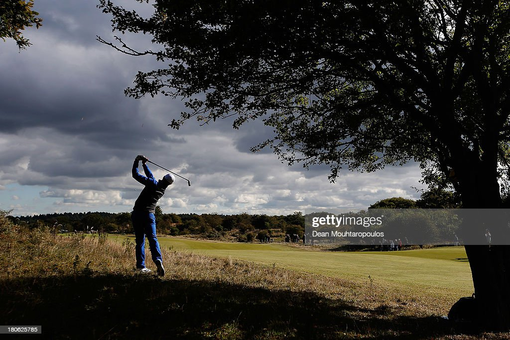 <a gi-track='captionPersonalityLinkClicked' href=/galleries/search?phrase=Oliver+Fisher&family=editorial&specificpeople=227218 ng-click='$event.stopPropagation()'>Oliver Fisher</a> of England hits his second shot on the 2nd hole during the Final Round of the KLM Open at Kennemer G & CC on September 15, 2013 in Zandvoort, Netherlands.