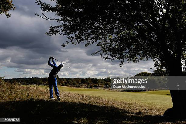 Oliver Fisher of England hits his second shot on the 2nd hole during the Final Round of the KLM Open at Kennemer G CC on September 15 2013 in...
