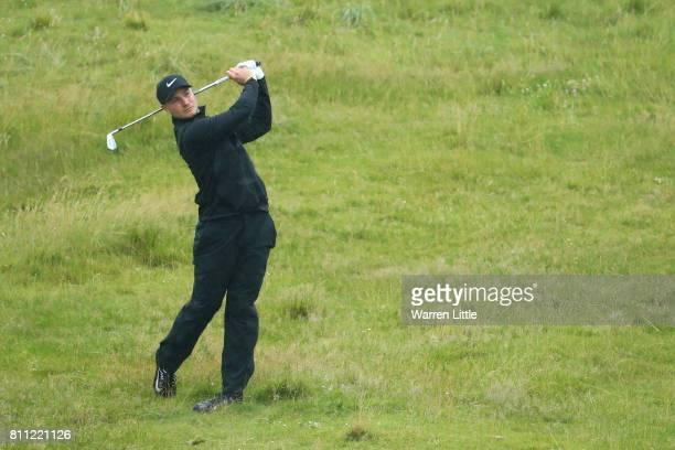 Oliver Fisher of England hits his second shot on the 2nd hole during the final round of the Dubai Duty Free Irish Open at Portstewart Golf Club on...