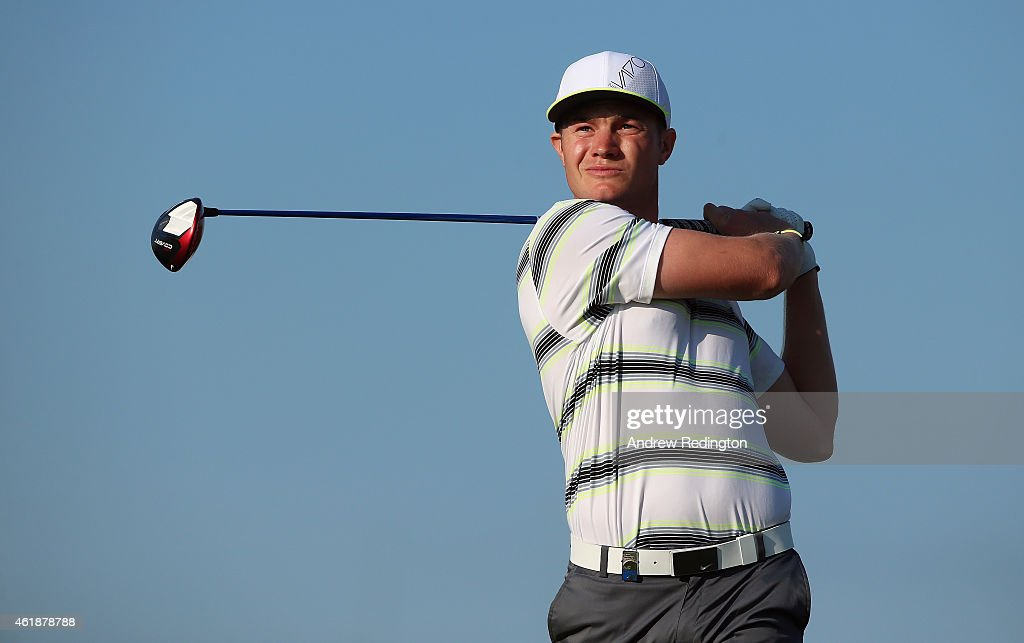 Oliver Fisher of England hits his teeshot on the ninth hole during the first round of the Commercial Bank Qatar Masters at Doha Golf Club on January...