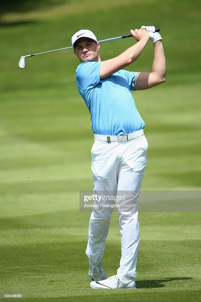 <a gi-track='captionPersonalityLinkClicked' href=/galleries/search?phrase=Oliver+Fisher&family=editorial&specificpeople=227218 ng-click='$event.stopPropagation()'>Oliver Fisher</a> of England in action during day one of the BMW PGA Championship at Wentworth on May 26, 2016 in Virginia Water, England.