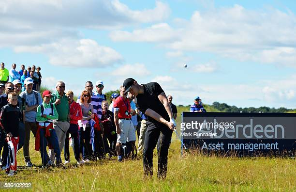 Oliver Fisher of England pitches onto the green on hole 16 on day three of the Aberdeen Asset Management Paul Lawrie Matchplay at Archerfield Links...