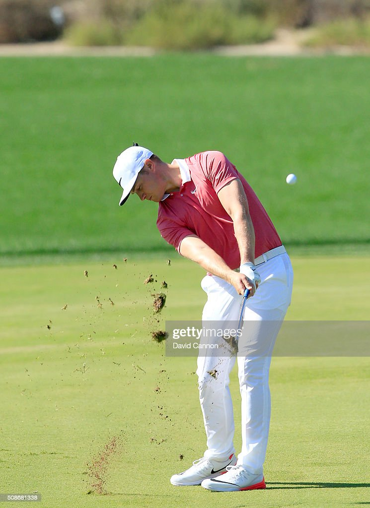 <a gi-track='captionPersonalityLinkClicked' href=/galleries/search?phrase=Oliver+Fisher&family=editorial&specificpeople=227218 ng-click='$event.stopPropagation()'>Oliver Fisher</a> of England plays his second shot at the par 4, second hole during the third round of the 2016 Omega Dubai Desert Classic on the Majlis Course at the Emirates Golf Club on February 6, 2016 in Dubai, United Arab Emirates.