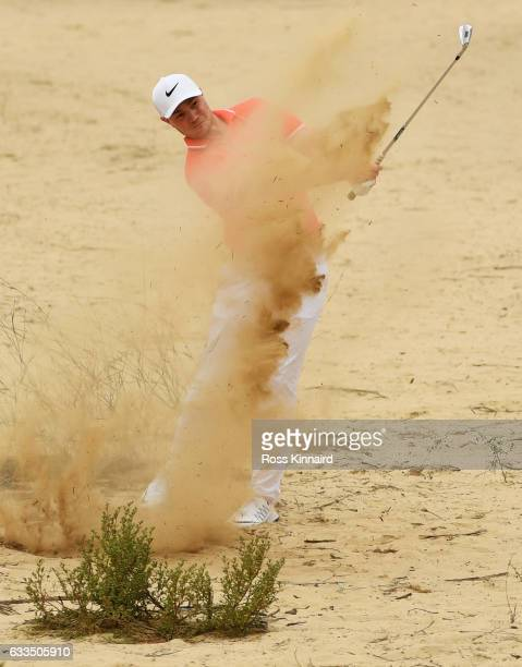 Oliver Fisher of England plays his second shot on the 13th hole during the first round of the Omega Dubai Desert Classic at Emirates Golf Club on...