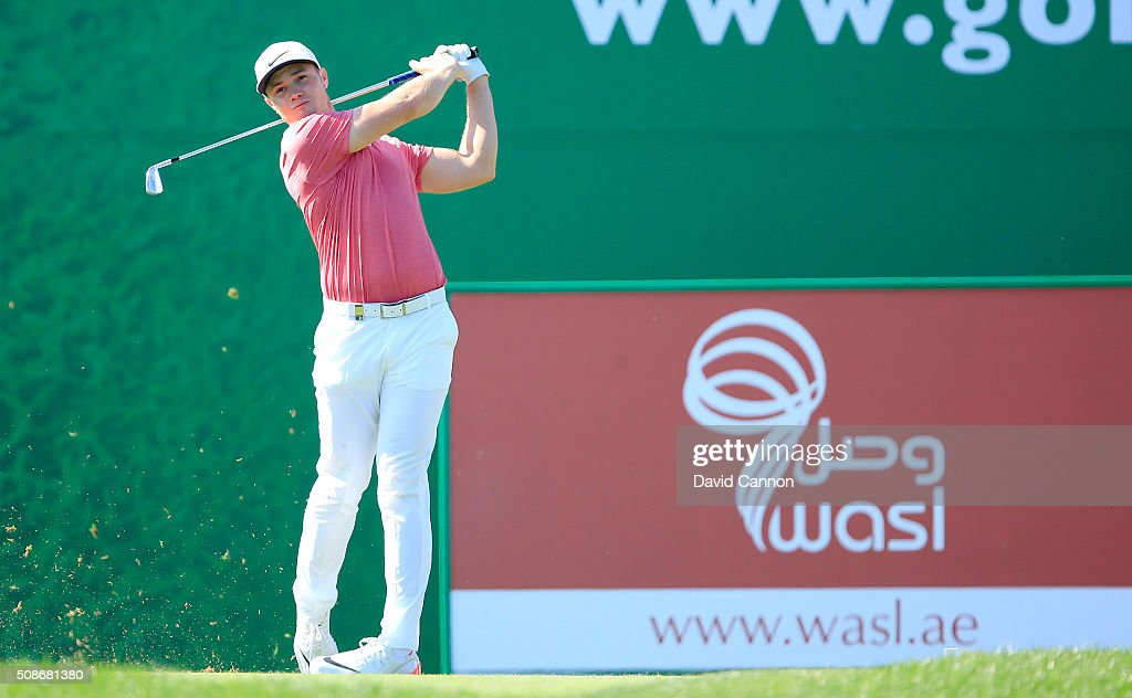 <a gi-track='captionPersonalityLinkClicked' href=/galleries/search?phrase=Oliver+Fisher&family=editorial&specificpeople=227218 ng-click='$event.stopPropagation()'>Oliver Fisher</a> of England plays his tee shot at the par 4, second hole during the third round of the 2016 Omega Dubai Desert Classic on the Majlis Course at the Emirates Golf Club on February 6, 2016 in Dubai, United Arab Emirates.