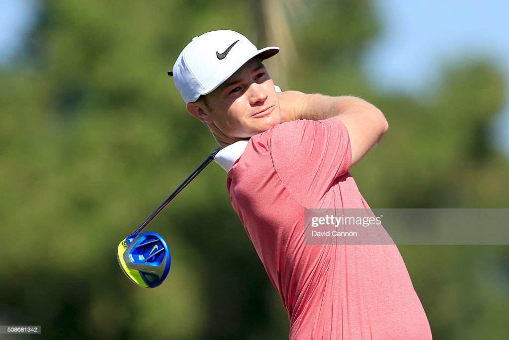 <a gi-track='captionPersonalityLinkClicked' href=/galleries/search?phrase=Oliver+Fisher&family=editorial&specificpeople=227218 ng-click='$event.stopPropagation()'>Oliver Fisher</a> of England plays his tee shot at the par 5, third hole during the third round of the 2016 Omega Dubai Desert Classic on the Majlis Course at the Emirates Golf Club on February 6, 2016 in Dubai, United Arab Emirates.