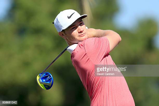 Oliver Fisher of England plays his tee shot at the par 5 third hole during the third round of the 2016 Omega Dubai Desert Classic on the Majlis...