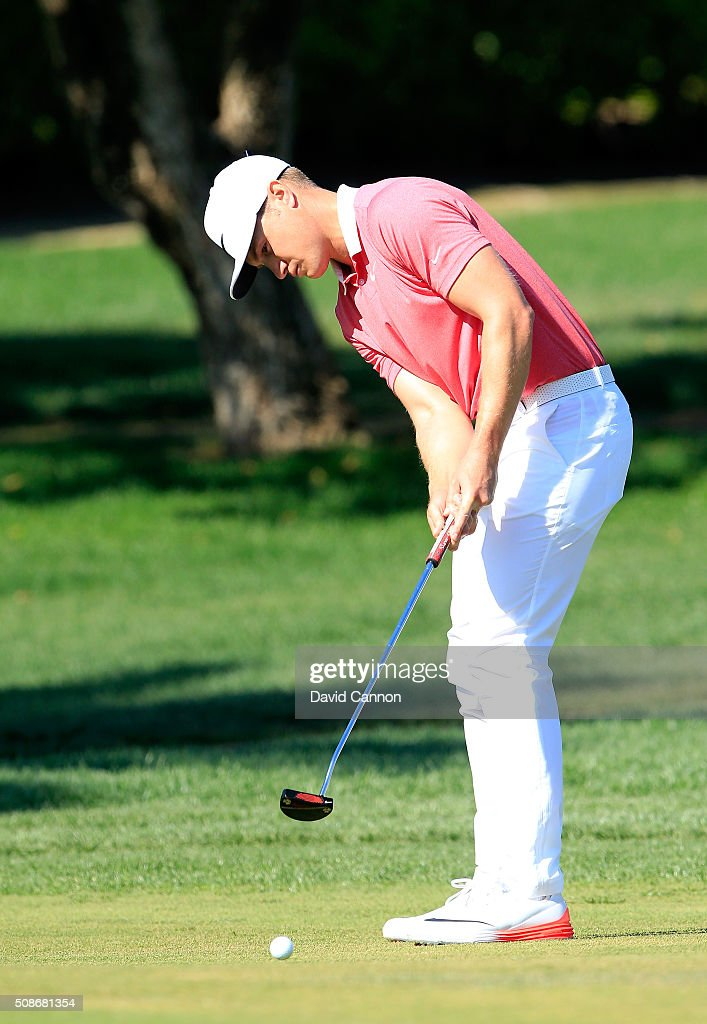 <a gi-track='captionPersonalityLinkClicked' href=/galleries/search?phrase=Oliver+Fisher&family=editorial&specificpeople=227218 ng-click='$event.stopPropagation()'>Oliver Fisher</a> of England plays his third shot at the par 4, first hole during the third round of the 2016 Omega Dubai Desert Classic on the Majlis Course at the Emirates Golf Club on February 6, 2016 in Dubai, United Arab Emirates.