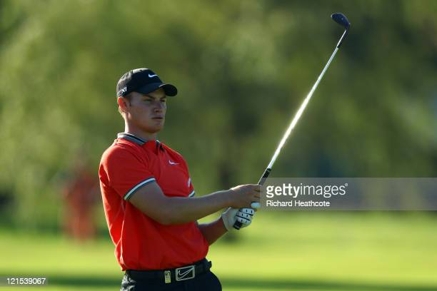 Oliver Fisher of England plays into the 18th green during the third round of the Czech Open 2011 at Prosper Golf Resort on August 20 2011 in Celadna...