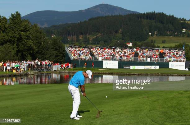Oliver Fisher of England plays into the 18th green on his way to victory during the final round of the Czech Open 2011 at Prosper Golf Resort on...
