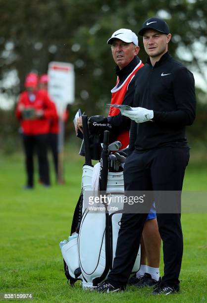 Oliver Fisher of England prepares to play his second shot on the first hole during day one of Made in Denmark at Himmerland Golf Spa Resort on August...