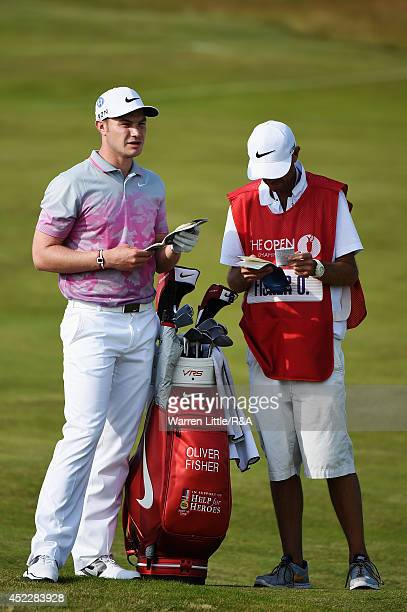 Oliver Fisher of England stands alongside his caddie Mark Sherwood during the first round of The 143rd Open Championship at Royal Liverpool on July...