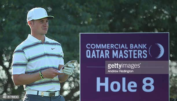 Oliver Fisher of England waits to hit his teeshot on the eighth hole during the first round of the Commercial Bank Qatar Masters at Doha Golf Club on...